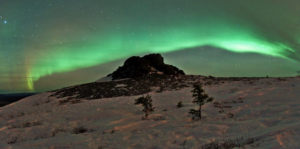 A two image panorama of the aurora over one of the rock outcroppings on Murphy Dome. It was a nice, warm night to go snowshoeing, but really windy.