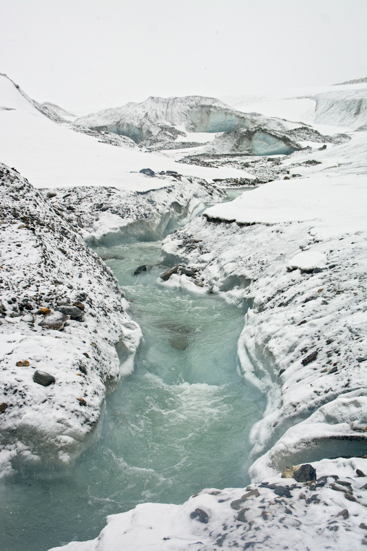 Fresh snow on a glacier stream in the Alaska Range