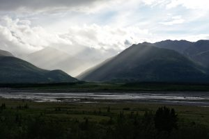 Light rays in the Alaska Range over the Delta River.
