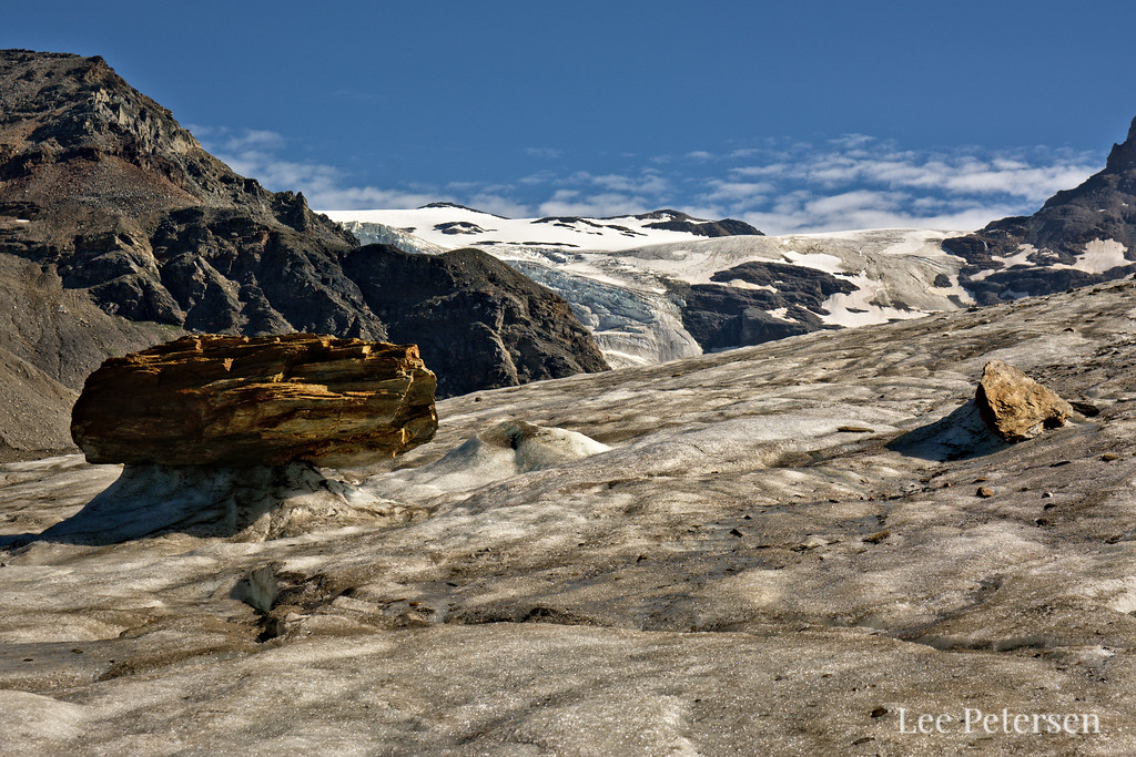Rocks on ice pedestals on the Castner Glacier. The rocks insulate the ice beneath them, so the surrounding ice melts faster.
