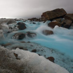 Blue stream on the Black Rapids Glacier in the Alaska Range